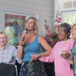 "Sing ""Amazing Grace"" with Esther (in pink) at an earlier visit"