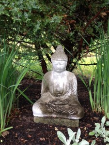 Buddha sitting and breathing calmly in my garden.